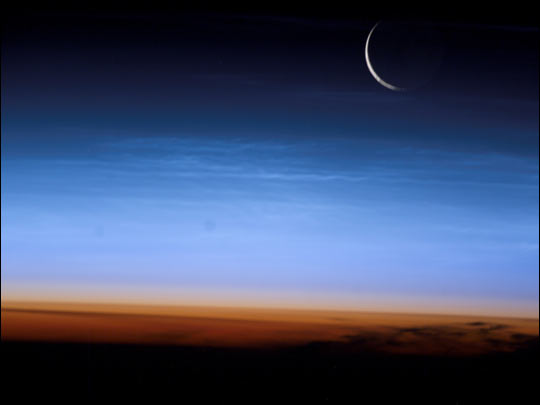 by NASA: a photo of noctilucent clouds